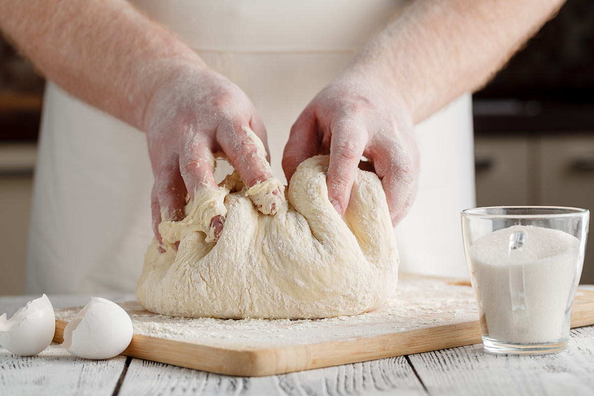 Kneeding dough with hands